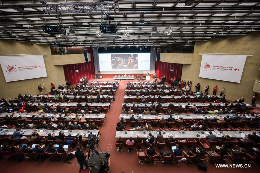 Delegates attend the opening ceremony of the 32nd International Conference of the Red Cross and Red Crescent in Geneva, Switzerland, Dec. 8, 2015.